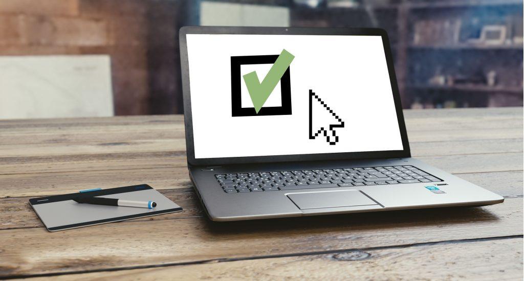 laptop displaying a green tick